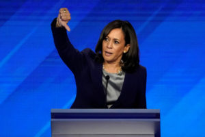 Senator Kamala Harris gives a thumbs down as she speaks during the 2020 Democratic U.S. presidential debate in Houston, Texas, U.S., September 12, 2019. REUTERS/Mike Blake