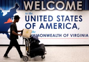 A man exits the transit area after clearing immigration and customs on arrival at Dulles International Airport in Dulles, Virginia, U.S., September 24, 2017.  REUTERS/James Lawler Duggan/Files