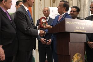 Ajit Pai, chairman of the Federal Communications Commission, receiving a plaque of recognition from President and CEO of the Indian American International Chamber of Commerce, K.V. Kumar, at a Nov. 6, 2019 event held at the Indian Consulate to launch the new New York chapter of IAICC.  Padma Shri Dr. Sudhir Parikh, left, looks on. (Photo courtesy IAICC)