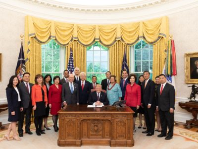 Prem Parameswaran, global chief financial officer of Eros International PLC, listed on the New York Stock Exchange, and president of Eros International Plc, 6th from left, at the May 14, 2019 event at White House with President Trump, when he signed an executive order to empower the Asian American and Pacific Islander communities as part of the Asian Pacific American Heritage Month  (Photo by White House photographer Joyce N. Boghosian via  Eros International Twitter)
