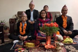 """Anil Subba with wife Shanta, on couch, and children, from left Tancho, Renu, and Parkash taken during """"Bhai pujan"""" the prayer for brothers' well-being, after ceremony (Photo: GoFundMe courtesy family)"""