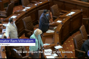 Illinois State Senator Ram Villivalam speaking on Senate Floor May 22, 2020, when the upper house passed legislation that would require the state to mail a ballot application to everyone who voted in 2018, 2019, or 2020, or who registered since the March 2020 primary in Illinois. Photo: videograb Facebook.