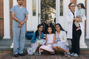 The Patel family is pictured at their home in Long Island, N.Y. From left to right: Tejas, Sonali, Suri, Shivani and Vihas, holding Roshan. The parents, both doctors, work long hours caring for covid-19 patients. MUST CREDIT: Photo by Celeste Sloman for The Washington Post