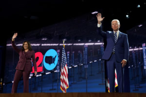 Democratic presidential candidate and former Vice President Joe Biden waves next to U.S. Senator Kamala Harris (D-CA) after she accepted the Democratic vice presidential nomination during an acceptance speech delivered for the largely virtual 2020 Democratic National Convention from the Chase Center in Wilmington, Delaware, U.S., August 19, 2020.   REUTERS/Kevin Lamarque