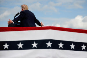 FILE PHOTO: U.S. President Donald Trump speaks during a campaign rally at Pitt-Greenville Airport in Greenville, North Carolina, U.S., October 15, 2020. REUTERS/Carlos Barria/File Photo