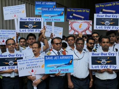 Jet Airways employees display placards during a protest at the Chhatrapati Shivaji Maharaj International Airport in Mumbai, India, May 8, 2019. REUTERS/Francis Mascarenhas/File Photo
