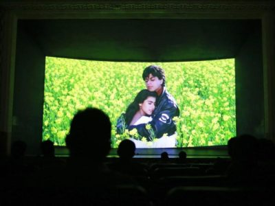 "Bollywood actors Shah Rukh Khan (R) and Kajol (L) are seen on the screen during the screening of ""Dilwale Dulhania Le Jayenge"" (The Big Hearted Will Take the Bride) inside Maratha Mandir theater in Mumbai December 11, 2014. The movie, released in October 1995, has set a record of completing 1000 weeks of continuous screening at a cinema, a feat unmatched by any other Bollywood movies. According to Manoj Desai, owner of the theatre, the movie, which is still being screened, enjoys at least 50 to 60 percent occupancy on weekdays and full house on weekends at his theatre. The movie is screened only in the morning and the ticket price ranges from 15 to 20 Indian rupees ($0.24-$0.32). Photo: Reuters, Danish Siddiqui"
