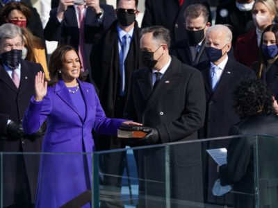 Kamala Harris is sworn in as U.S. Vice President as her spouse Doug Emhoff holds a bible during the inauguration of Joe Biden as the 46th President of the United States on the West Front of the U.S. Capitol in Washington, U.S., January 20, 2021. REUTERS/Kevin Lamarque