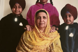 Amarjeet Kaur Johal, one of the victims in the April 16, 2021 mass killing at Fedex facility in Indianapolis, with her grandchildren. Photo: courtesy of family, via Sikh Coalition