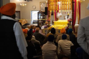 Members of the Sikh community gather in mourning in Indianapolis on Saturday, April 17, 2021. Four Sikhs were among the victims of a mass shooting at a FedEx facility nearby the day before. MUST CREDIT: Photo for The Washington Post by Megan Jelinger