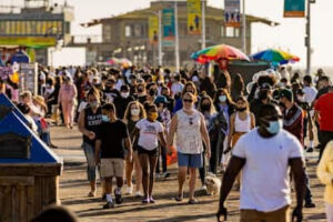 People walk along Santa Monica Pier in Los Angeles on April 8, 2021. MUST CREDIT: Bloomberg photo by Roger Kisby.